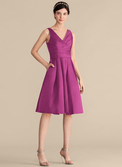 A-Line/Princess V-neck Knee-Length Satin Bridesmaid Dress With Ruffle Pockets